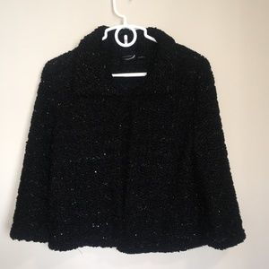 Black jacket with glitter.